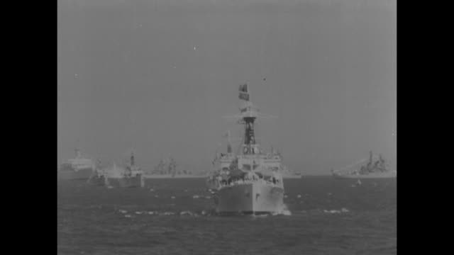 aerial british navy fleet at spithead / queen elizabeth ii looks through binoculars from glass cabin of royal yacht hms surprise as she reviews the... - marine stock-videos und b-roll-filmmaterial