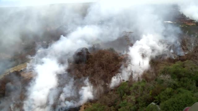 Aerial broll of lava fissure breakouts in Leilani Estates/Puna Lava Flow shot from a Hawaii Army National Guard UH60 Blackhawk helicopter during...