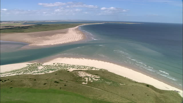 aerial budle bay on coast of northumberland / england - northumberland coast stock videos & royalty-free footage