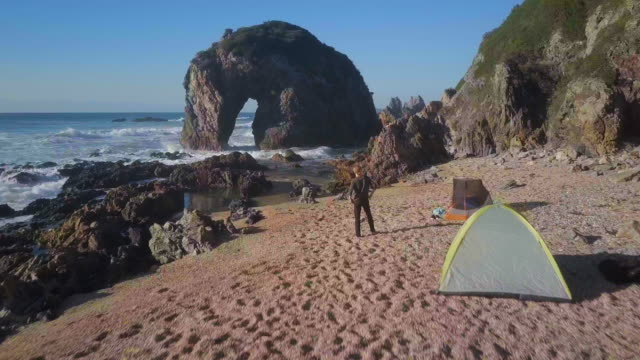 aerial: camping on scenic beach with stunning rocks, bermagui, australia - tent stock videos & royalty-free footage