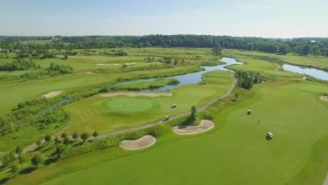 4k aerial canada: grey silo golf course - green golf course stock videos & royalty-free footage