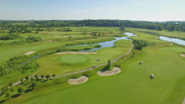 4k aerial canada: grey silo golf course - golf course stock videos & royalty-free footage