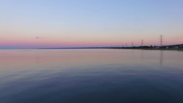 4k aerial canada: lake ontario sunset - ontario canada stock videos & royalty-free footage