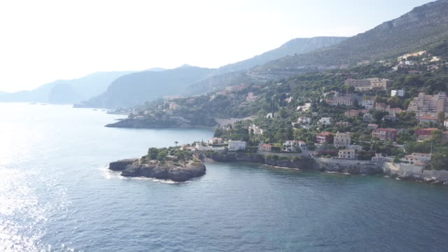 aerial, cap d'ail and mala beach - water's edge stock videos & royalty-free footage