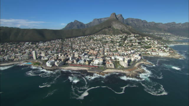 Aerial, Cape Town, Lion's Head, Table Mountain and Coastline, travel to Signal Hill and Sea Point and Green Point Coastline to Waterfront. South Africa