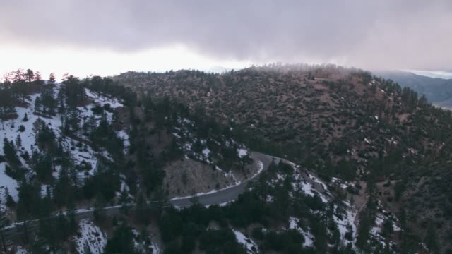 aerial car driving around snowy mountain road - angeles national forest stock videos and b-roll footage