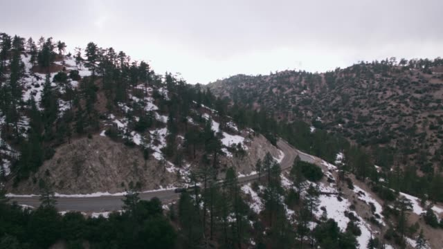 aerial car driving curvy mountain road - angeles national forest stock videos and b-roll footage