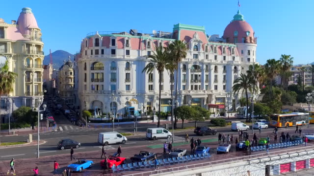 aerial: car show and architecture on nice's oceanfront promenade - dome stock videos & royalty-free footage