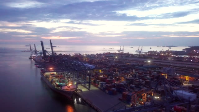 aerial cargo ship at the container at dusk - stationary stock videos & royalty-free footage