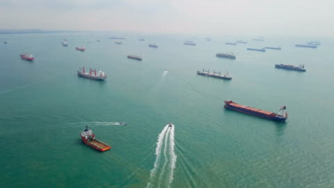 aerial cargo ships anchored in the sea. singapore - harbour stock videos & royalty-free footage