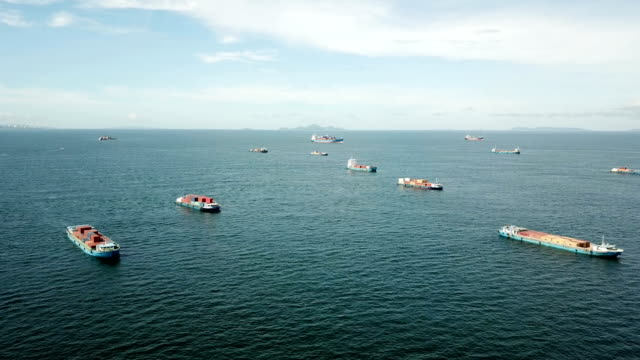aerial cargo ships anchored in the sea - anchored stock videos & royalty-free footage