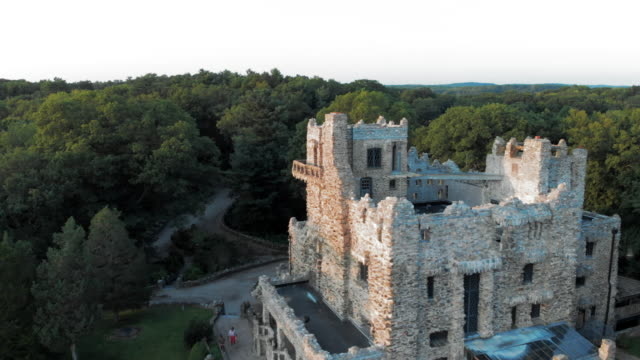 aerial: castle in the trees above lake - connecticut stock-videos und b-roll-filmmaterial
