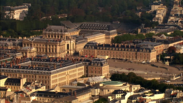 aerial ws chateau de versailles and surrounding buildings / versailles, ile-de-france, france - chateau de versailles stock videos and b-roll footage