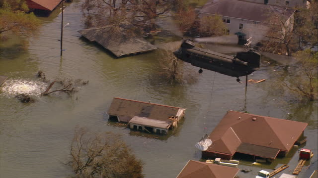 aerial chinook helicopter carrying sand bags to broken levee on london ave canal /new orleans low angle - hurricane katrina stock videos and b-roll footage
