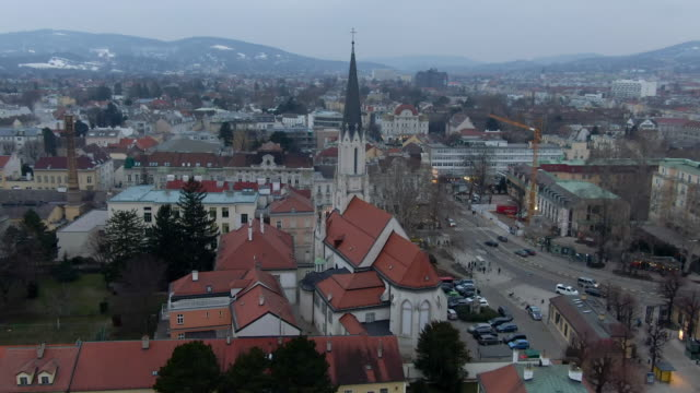 aerial: church with tall steeple in vienna cityscape, austria - steeple stock videos & royalty-free footage