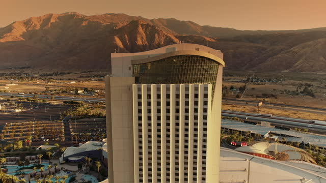 ws aerial circling around american indian casino hotel tower in southern california desert - agua stock-videos und b-roll-filmmaterial
