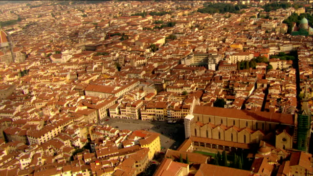 aerial circling over basilica of santa croce with view of santa maria del fiore and  arno / florence - florence italy stock videos and b-roll footage