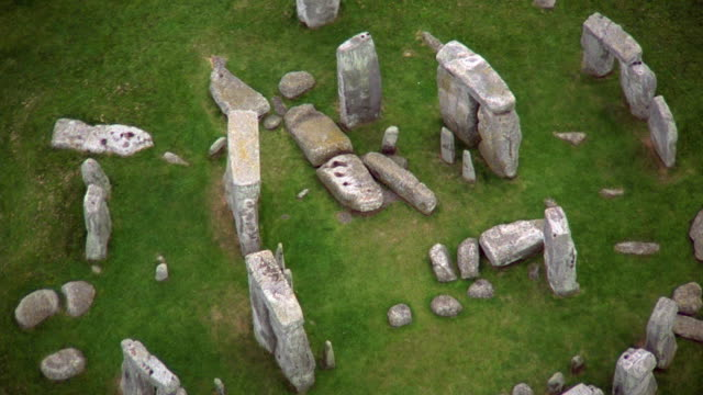 aerial circling over stonehenge / england - stonehenge stock videos and b-roll footage