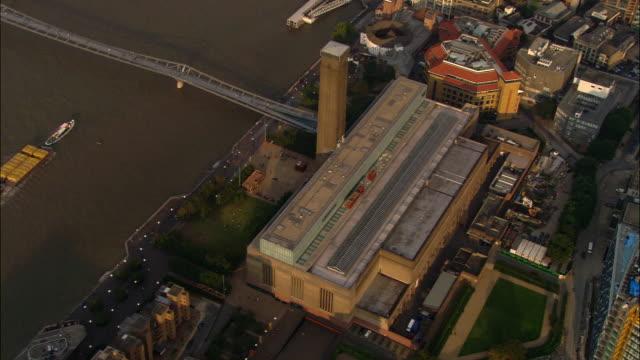 aerial circling over tate modern and millennium bridge on thames / london - london millennium footbridge stock videos and b-roll footage
