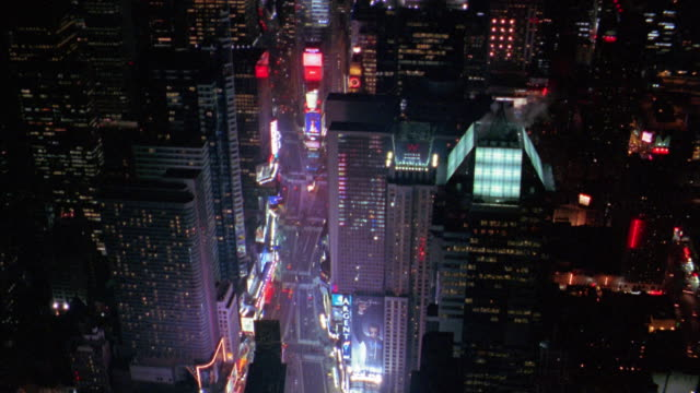 aerial circling over times square at night - tabellone video stock e b–roll
