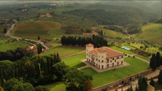 aerial circling over villa south of siena in tuscan countryside / italy - villa stock videos & royalty-free footage