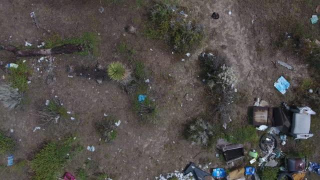 aerial circling pan of garbage - プラスチック汚染点の映像素材/bロール