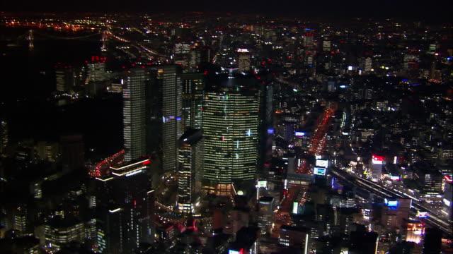 Aerial circling Shiodome area at night/ Tokyo / November 16, 2005