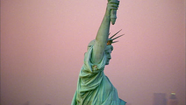 aerial circling statue of liberty - statue of liberty new york city stock videos & royalty-free footage