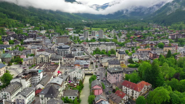 aerial circling: stunning lush green mountains over scenic town - chamonix, france - france stock videos & royalty-free footage