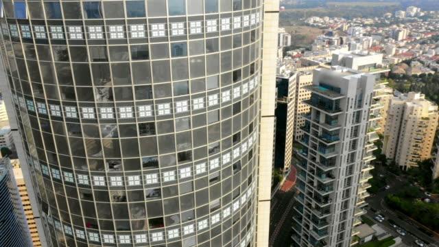 aerial circling: stunning modern buildings in tel-aviv, israel - テルアビブ点の映像素材/bロール