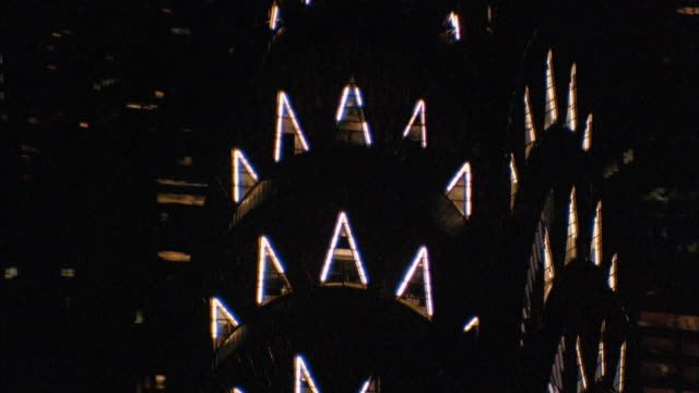 aerial circling top of chrysler building to top of empire state building at night - chrysler building stock-videos und b-roll-filmmaterial