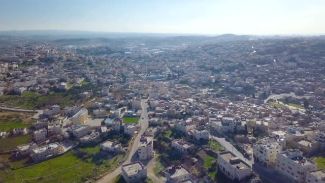 aerial / city of hebron, palestinian territories - gaza city stock videos & royalty-free footage