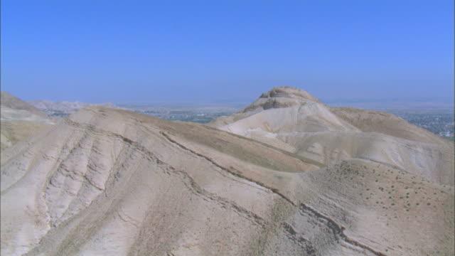 Aerial city of Jericho from over desert hills, Judea Desert, Israel