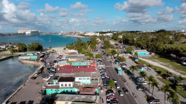 vídeos y material grabado en eventos de stock de aerial: city of nassau, neighborhood, traffic, and huge cruise ship in water - bahamas