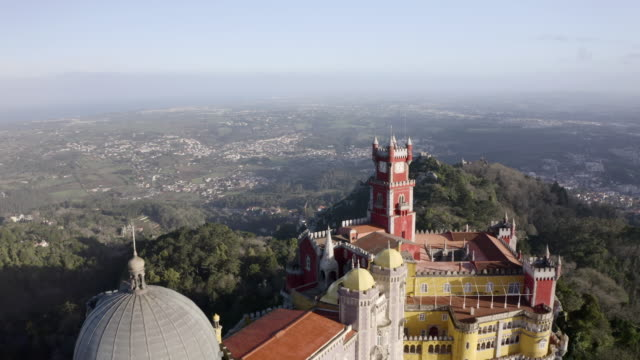aerial: city of sintra and the palace de pena on the top of a mountain - top garment stock videos & royalty-free footage