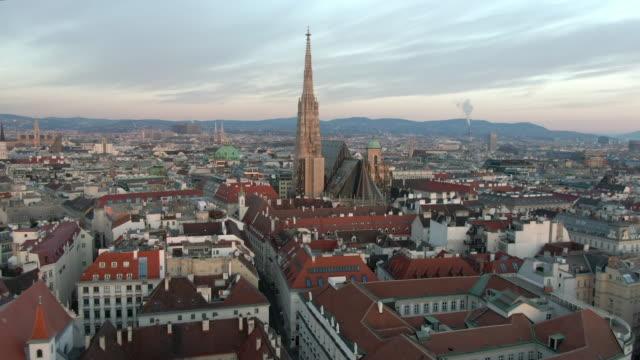 aerial: city rooftops and st. stephen's cathedral in vienna, austria - spira tornspira bildbanksvideor och videomaterial från bakom kulisserna