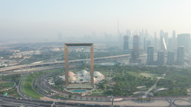 aerial city view of famous landmark, dubai frame during the day located in zabeel, dubai, uae - border stock videos & royalty-free footage