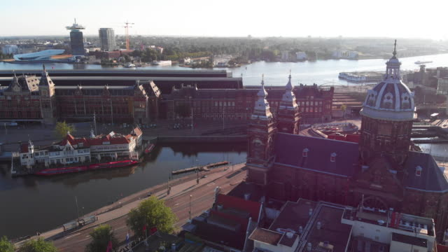 aerial cityscape, amsterdam centraal train station - amsterdam stock videos & royalty-free footage