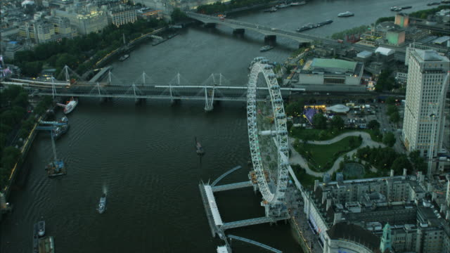 aerial cityscape night view river thames london uk - millennium wheel stock videos and b-roll footage