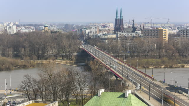 aerial cityscape timelapse of bridge over the wisla river in warsaw, poland. april, 2017. - poland stock videos and b-roll footage