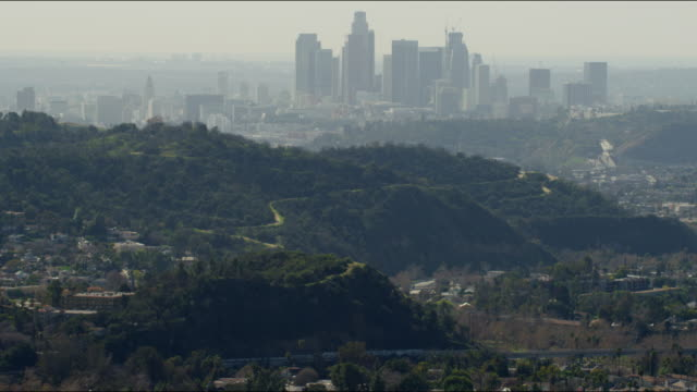 aerial cityscape view of los angeles skyscrapers usa - aerial transport building stock videos & royalty-free footage