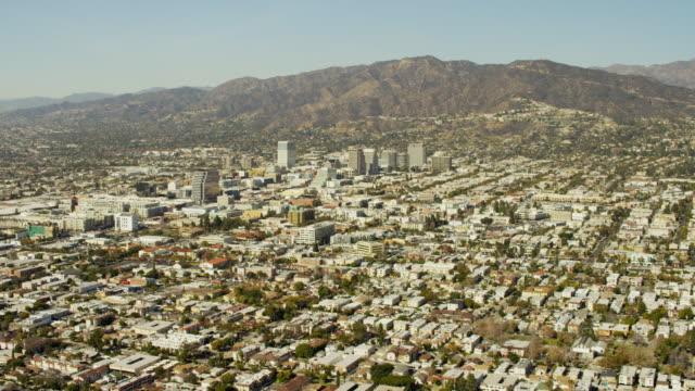 aerial cityscape view of suburban burbank glendale california - burbank stock-videos und b-roll-filmmaterial