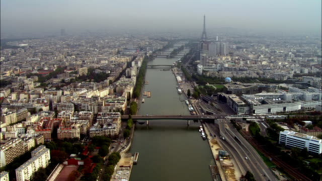 aerial ws cityscape with eiffel tower and river seine / paris, france - river seine stock videos & royalty-free footage