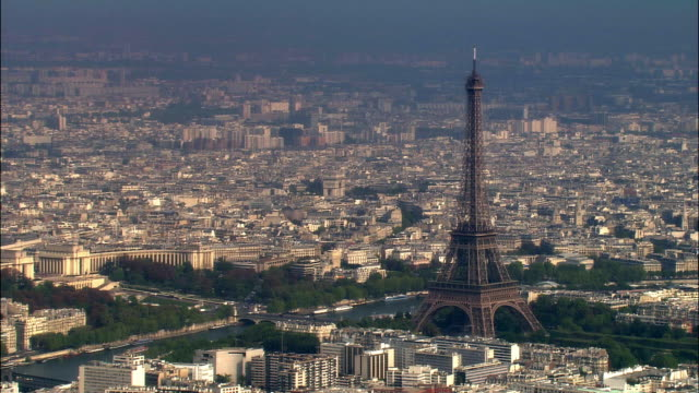 Aerial WS Cityscape with Eiffel Tower and River Seine / Paris, France