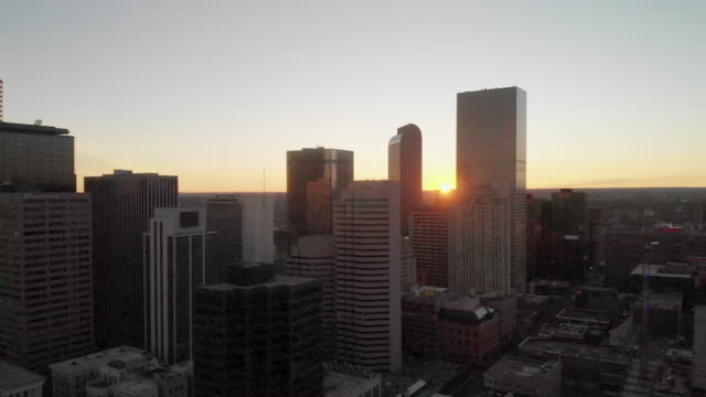 aerial clip of downtown denver at sunrise with skyscrapers - colorado stock videos & royalty-free footage