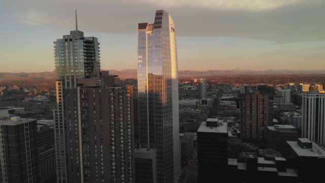 aerial clip of downtown denver at sunrise with skyscrapers - denver stock videos & royalty-free footage