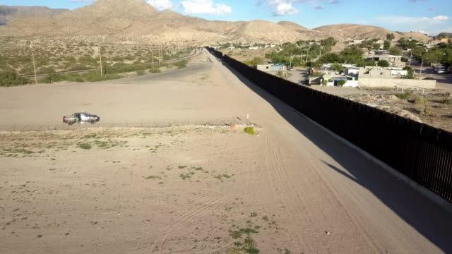 aerial clip of the us/mexico border wall between new mexico and chihuahua - prison reform stock videos & royalty-free footage
