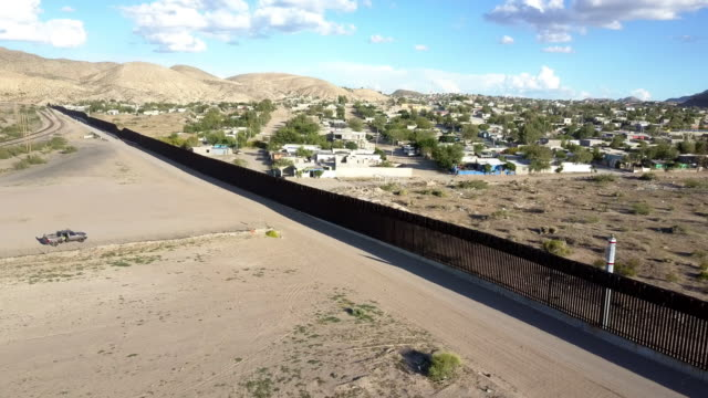 aerial clip of the us/mexico border wall between new mexico and chihuahua - refugee camp stock videos & royalty-free footage