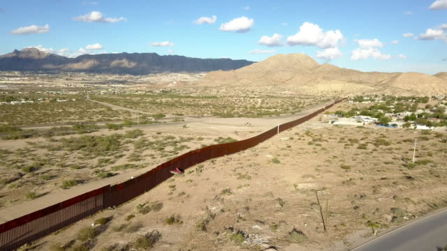 aerial clip of the us/mexico border wall between new mexico and chihuahua - texas stock videos & royalty-free footage