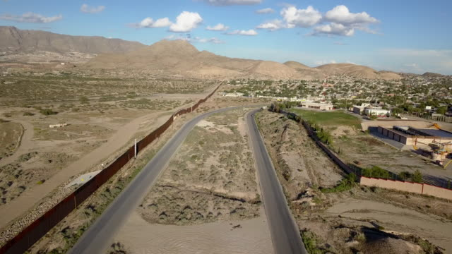 aerial clip of the us/mexico border wall between new mexico and chihuahua - federal prison stock videos & royalty-free footage